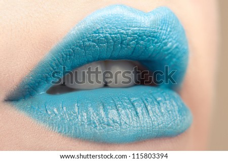 close-up body part portrait of beautiful woman's lips bright blue make up
