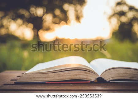 Close up book on table, retro color - stock photo