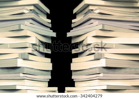 Close up book stacked  with the black background - stock photo