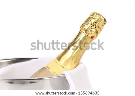 Close up bottle of champagne in cooler. Isolated on white background.