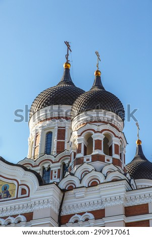 Close up bottom view of the dome of Alexander Nevsky Cathedral in Tallinn, Estonia, on blue sky background. - stock photo