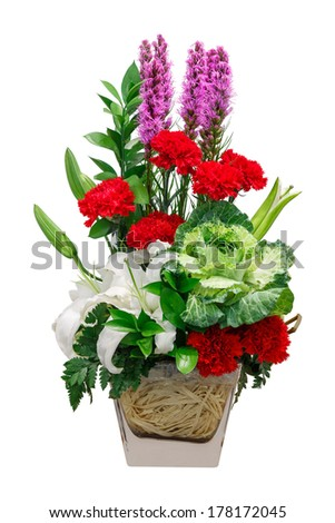Close up bouquet of lily cabbage and red carnation flower in glass vase isolated on white