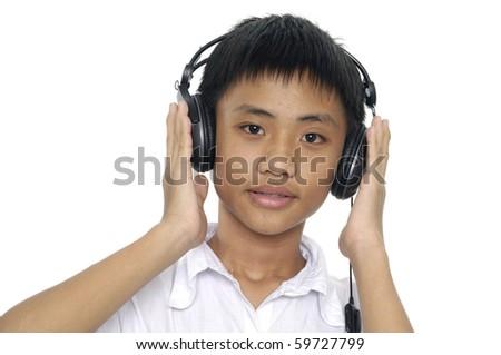 Close up boy listening music in headphones - stock photo