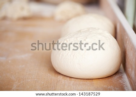Close up bread dough on wooden bakery table