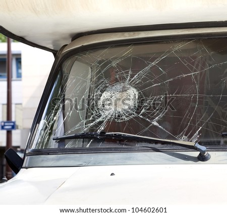Close-up broken car windshield on the passenger side - stock photo
