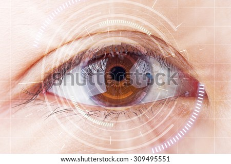 Close-up brown eye the future cataract protection , scan, contact lens. - stock photo