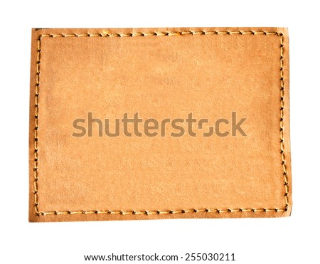 close up brown leather jeans empty on isolated white with space