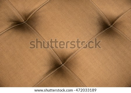 Close up Brown Leather sofa for texture abstract background