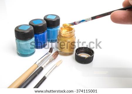 Close up brush and paint isolated on white background - stock photo