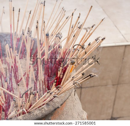 Close up burning incense in the temple - stock photo