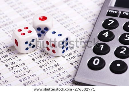 Close up Business analysis with dice and calculator