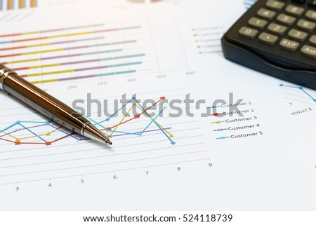Close up business concept, Pen is on summary report and calculator on table office.