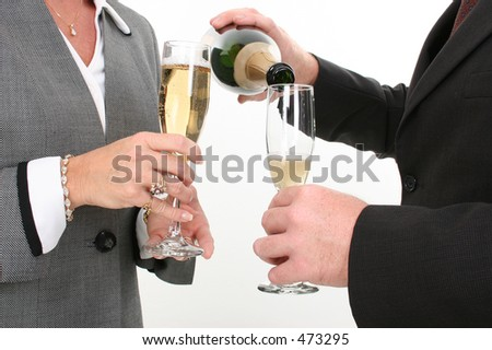 Close-up Business Couple Pouring Champagne.