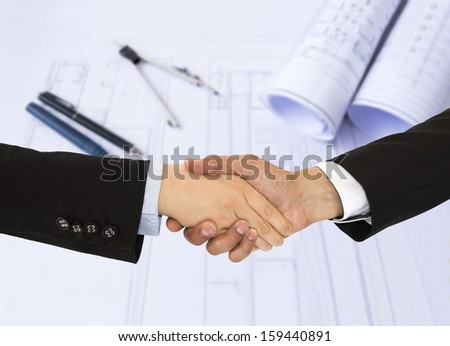 close up business handshake of architecture - stock photo