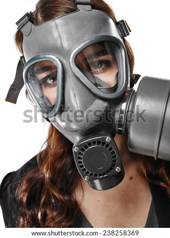 Close up, business looking young adult woman posing on a personal gas mask on her face - white background - stock photo