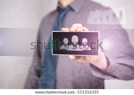 "Close-Up Businessman Holding A Smartphone With The Icon ""Customers"" Business concept. Internet concept."