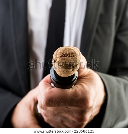 Close up Businessman Opening Bottle of Wine with 2015 Text on the Cork. - stock photo