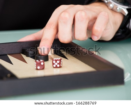 Close-up Businessman Playing Backgammon At Office Desk - stock photo