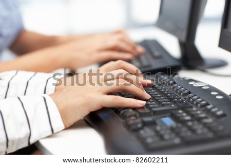 Close up businesswomen typing - stock photo
