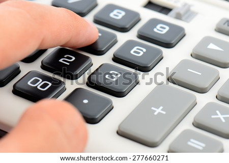 close up calculator with finger