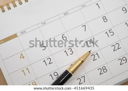 close up calendar date and pen - stock photo