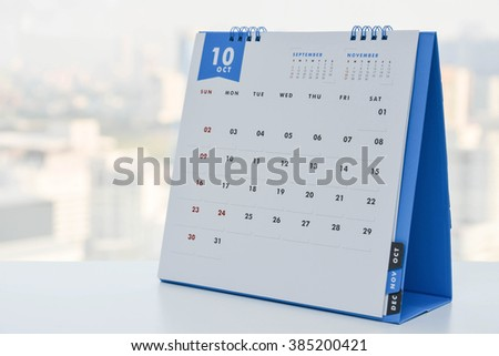 Close up - Calendar of October on the white table with city view background - stock photo