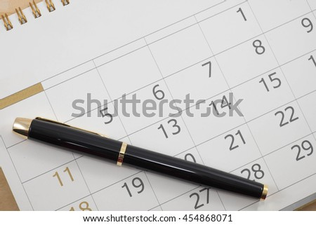 close up calender date and pen - stock photo