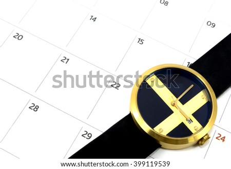 close up calender date and watch - stock photo