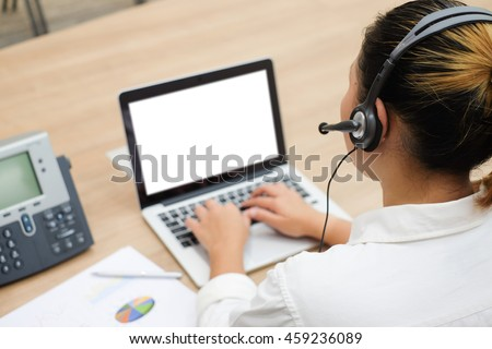 close up call centre woman working in office room:focus on headphone of asian girl response answer customer question or partner concept:people technology innovation:service support business:operation - stock photo