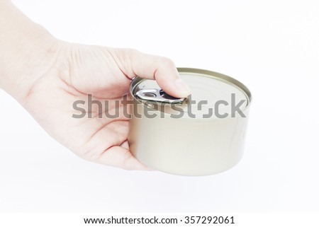 Close-up can with hand isolated on white background, stock photo - stock photo