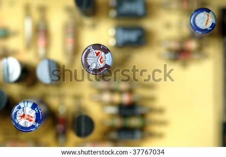 close-up capacitors on a circuit board - stock photo