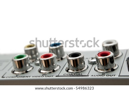 Close up capturing audio visual sockets on the rear of an electrical device. White background. - stock photo