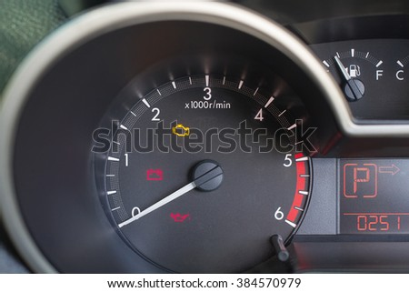 Close up Car Speed Dashboard, with alarm sign display.