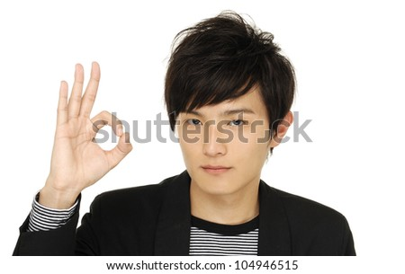 Close up casual young woman smiling doing the ok sign - stock photo