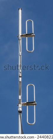 Close up Cellular transmitter, dipole antenna for telecommunications with clear blue sky background. - stock photo