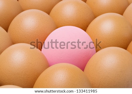 Close up Century egg among chicken eggs - stock photo