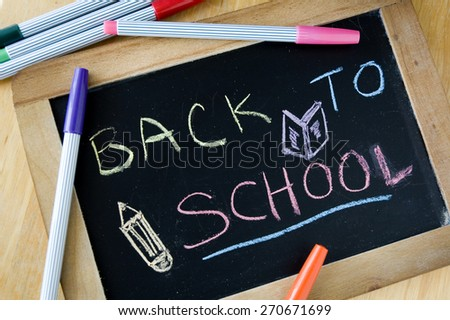 close up chalkboard writing back to school - stock photo
