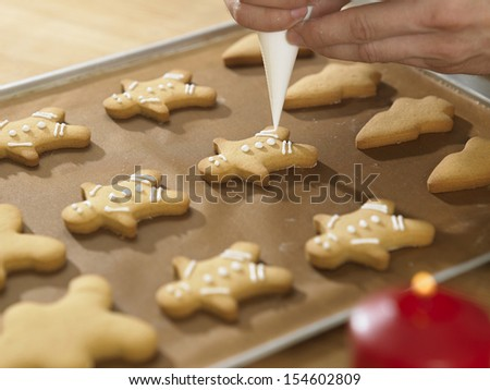 close up  chef decorating cookies with icing sugar - stock photo