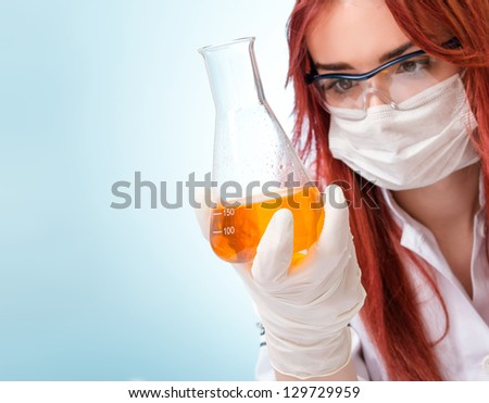 Close-up Chemist woman, focus on test tubes - stock photo