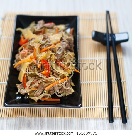 close-up chinese rice noodles with meat and vegetables - stock photo