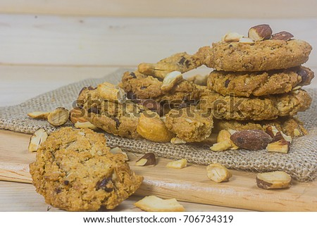 Close up chocolate cookies with Cashews and bread on a shabby wooden table background