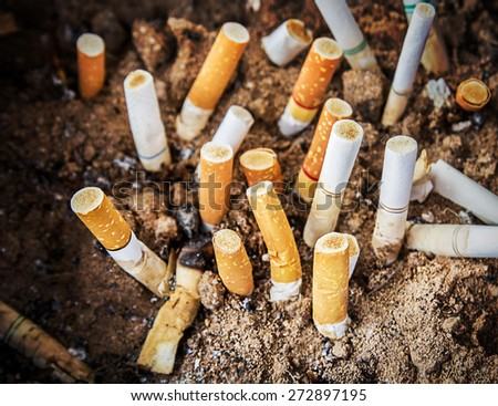 Close up cigarettes butt in ashtray  - stock photo