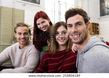 Close up Circle of Young Adult White Friends in Casual Outfits Looking at the Camera with Happy Facial Expression. - stock photo
