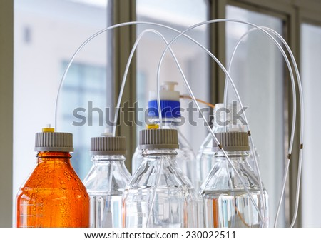 Close up clear and amber color bottle with plastic hose for High performance liquid chromatography - HPLC - stock photo