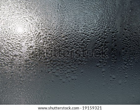 Close-up clear drops of water on window glass surface - stock photo