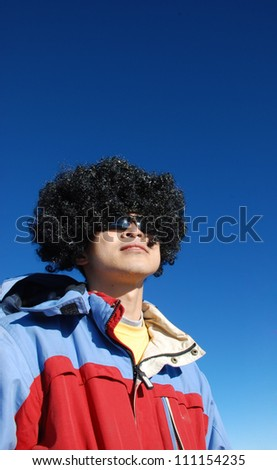Close up climbing man with blue sky - stock photo