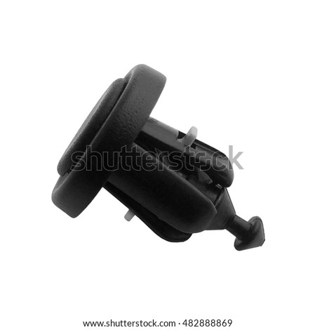 Close-up closed black fastening clip push-type retainer for car bumper on an isolated white background