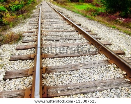 Close up / closeup of a speedway / railroad / old rail / railroad track - stock photo