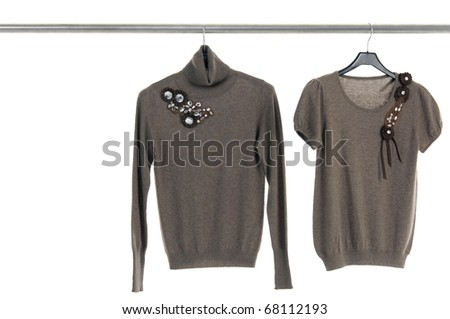 Close up clothing hanging a on display - stock photo