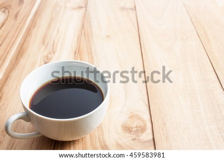 close up cofee cup on table wooden